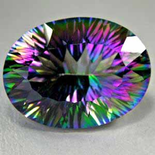 Mystic Topas, 32.50 Carat, IF, oval, excellent