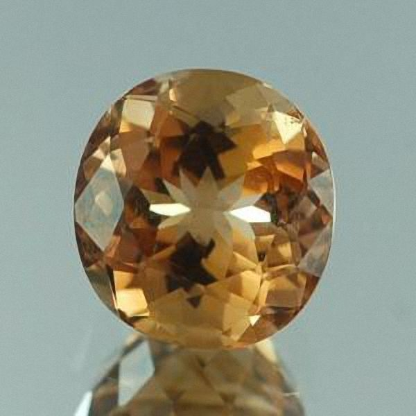 Golden Topas, 18.40 Carat, IF, oval, excellent